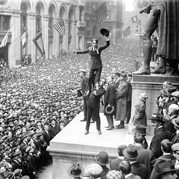 "Charlie Chaplin, on Douglas Fairbanks"" shoulders, promoting Liberty Bonds at a 1918 rally in New York City."