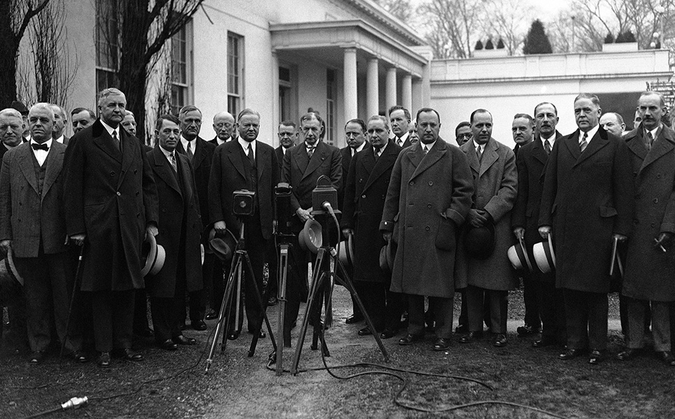 "President Herbert Hoover and reconstruction leaders meet in Washington on February 6, 1932, to discuss the president""s contemplated campaign against national hoarding."