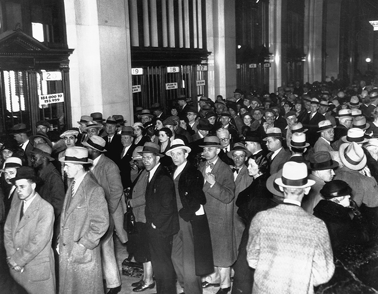 Thousands of people stand in line to receive 30% of their deposits during the National Banking Emergency of 1933.