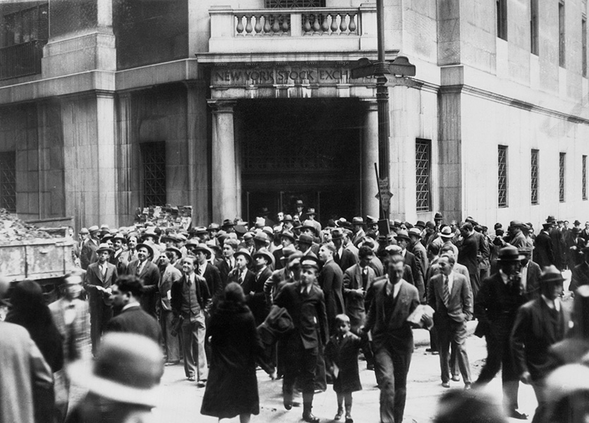 A crowd gathers outside the New York Stock Exchange following the 1929 crash.