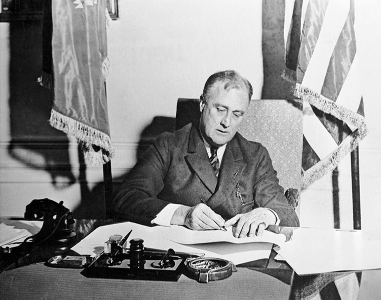 President Franklin Roosevelt signing the Emergency Banking Act