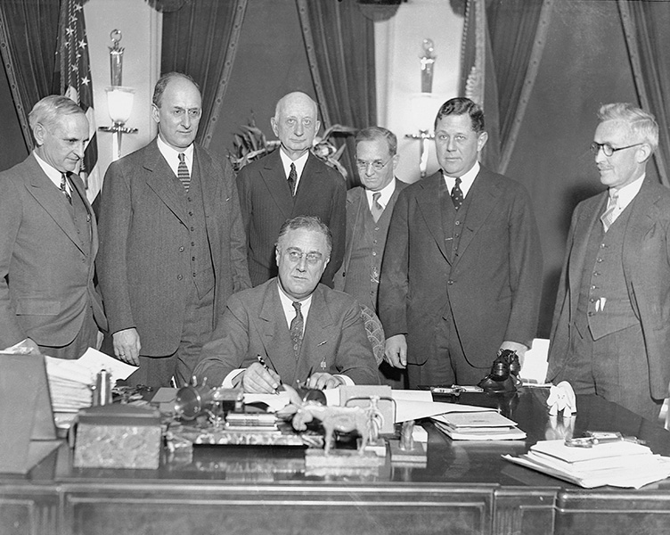 President Roosevelt signs the Gold Reserve Act.