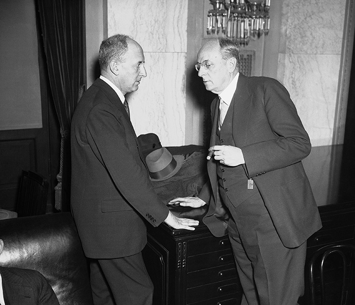 "Henry Morgenthau speaks with Attorney General Homer Cummings, who had gone before the Senate Banking Committee to assure members of the constitutionality of FDR""s proposal that the Treasury be given title to the Federal Reserve System""s gold stocks."