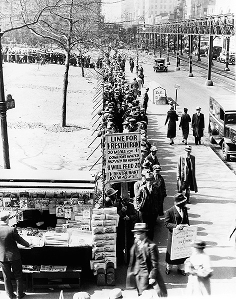 A long bread line stretches down a New York City street during the Great Depression.