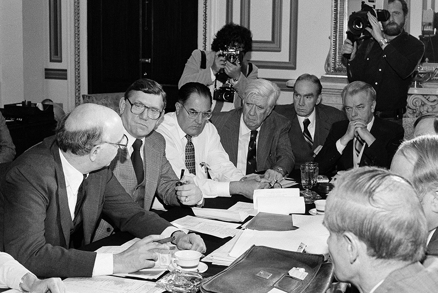 Paul Volcker, Chairman of the Federal Reserve Board, speaks at a meeting of Congressional leaders who were proposing budget cuts.