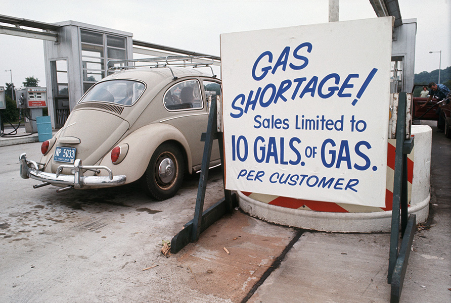 "Sign reading ""Gas shortage! Sales limited to 10 gallons of gas per customer"" posted at a filling station during the energy crisis"