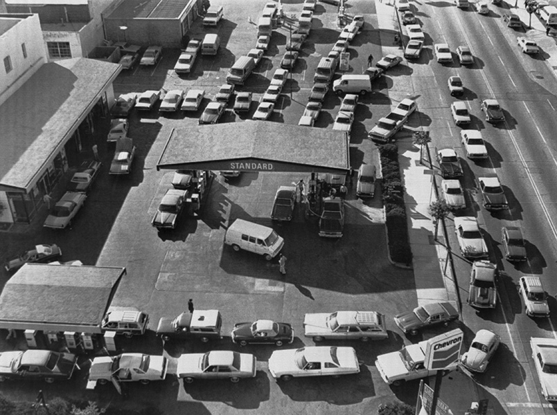 Cars line up outside a filling station on the first day of gas rationing following the revolution in Iran that caused a shortage of crude oil.
