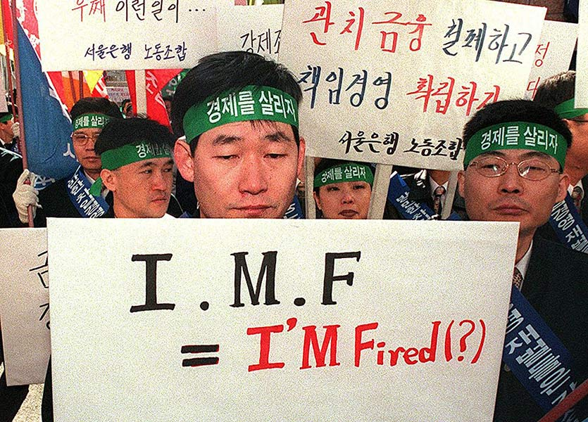 "A South Korean labor union member of Seoulbank, one of South Korea""s most bad-debt burdened commercial banks, looks downcast. Reports say that the IMF is pushing for the opening of South Korea""s financial and banking business as part of the IMF bailout."