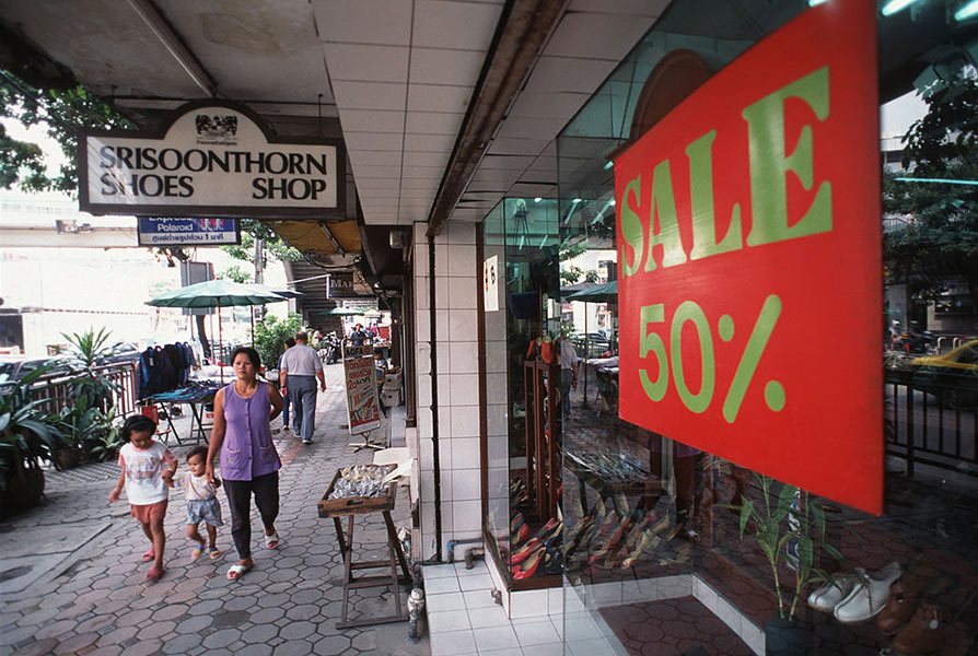 A Bangkok, Thailand, shop offers 50% off in a desperate attempt to lure customers who have lost their spending power after the economic crash of 1997.
