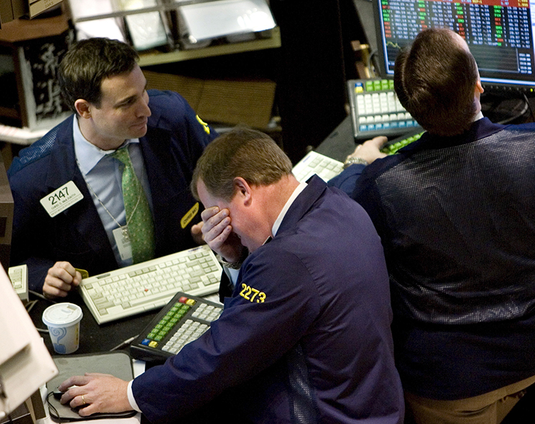 "Traders await news of the Federal Reserve""s response to the mortgage crisis at the New York Stock Exchange."