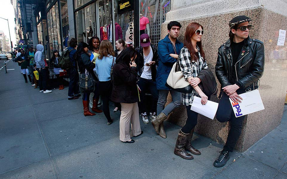 Job seekers line up to apply for positions at an American Apparel store April 2, 2009 in New York City. Weekly unemployment claims have reached a 26-year high.