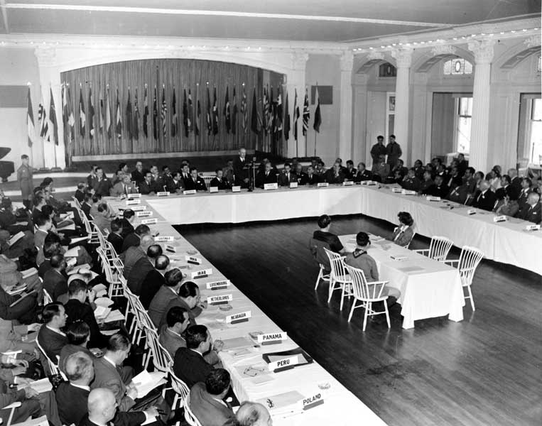 Delegates from 44 countries listen to Senator Charles Tobey speak at the plenary session of the United Nations Monetary Conference in Bretton Woods, New Hampshire.