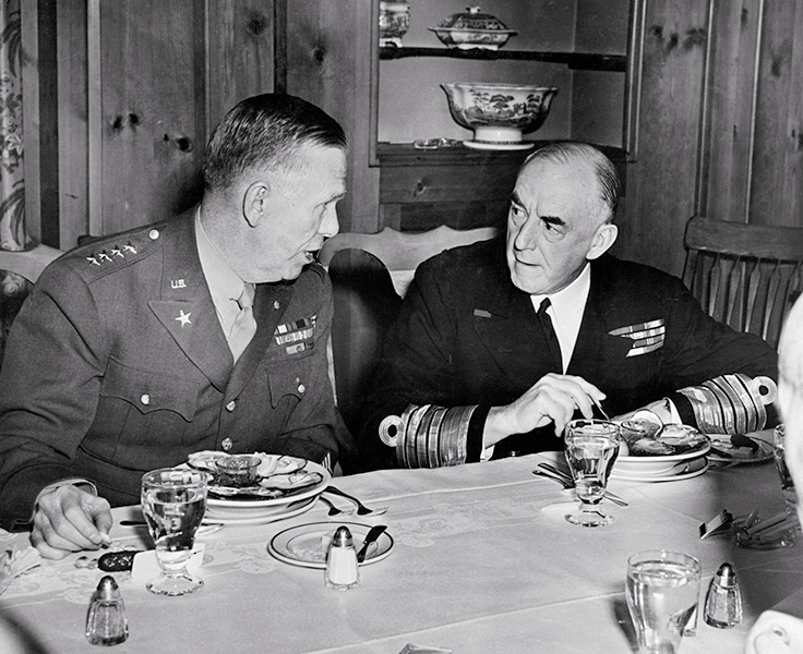 U.S. Army Chief of Staff George C. Marshall and British Admiral Sir Dudley Pound talk at luncheon held for British and American naval chiefs at the Federal Reserve building in Washington, D.C.