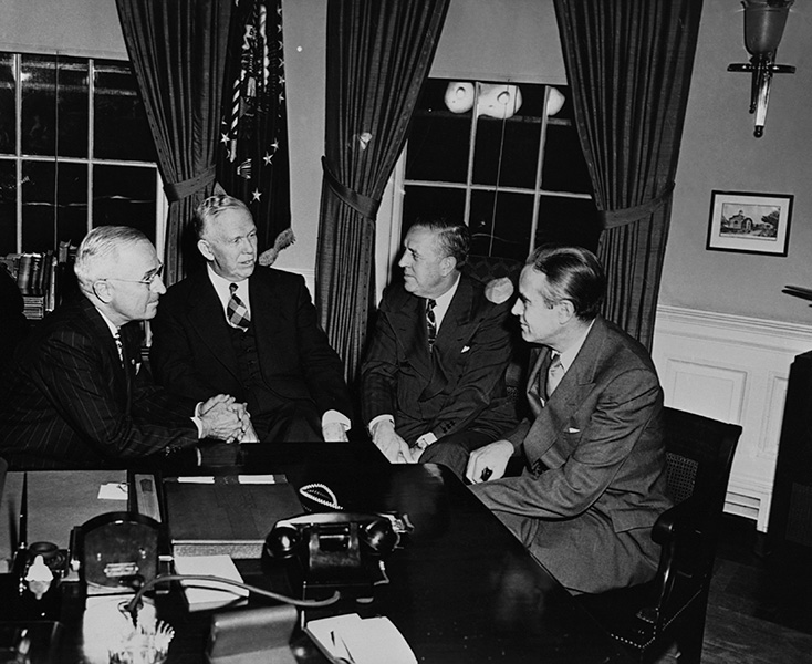 President Harry Truman meets with George Marshall, Economic Cooperation Administration chief Paul Hoffman, and ECA roving ambassador W. Averell Harriman to discuss the Marshall Plan.